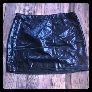 Express medium fake leather skirt , elasticized.
